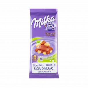 Шоколад молочный Milka с целым лесным орехом